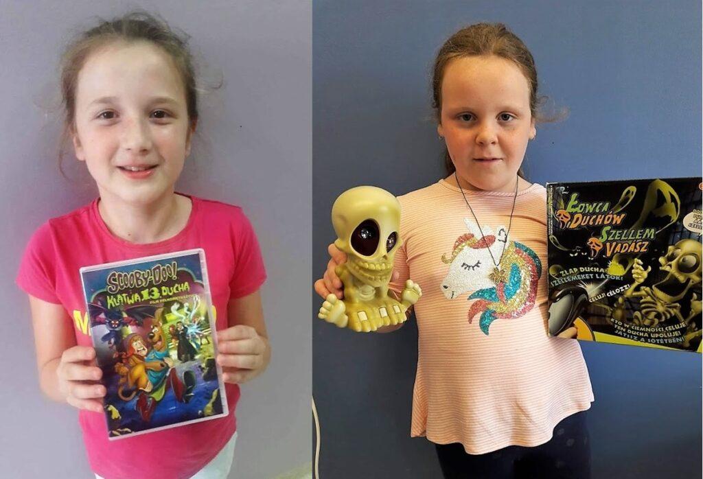 Obraz przedstawia naszych wychowanków, którzy trzymają nagrody za osiągnięcia w konkursach organizowanych na portalu sieciaki.